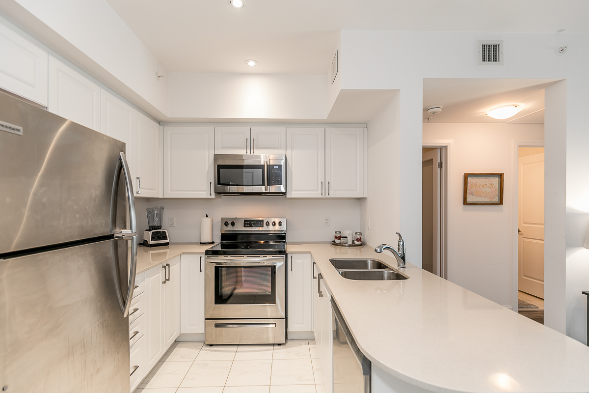 SOLD OVER ASKING - Completely Upgraded 1+Den with Treed View